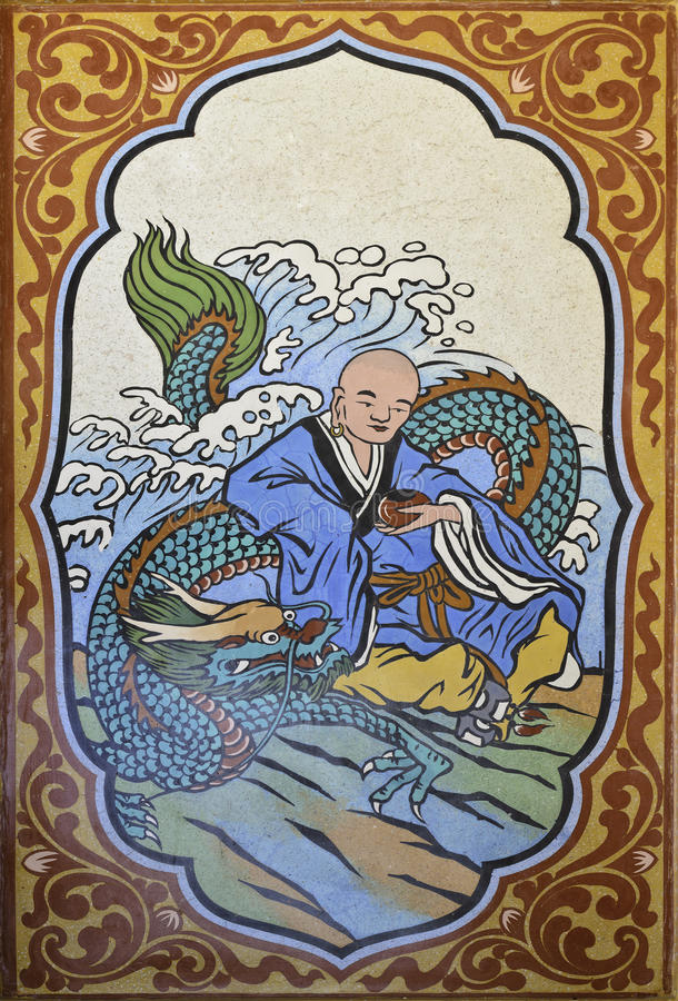 Chinese dragon and Chinese monk painting on wall in chinese temple. At Songkhla, South of Thailand stock image