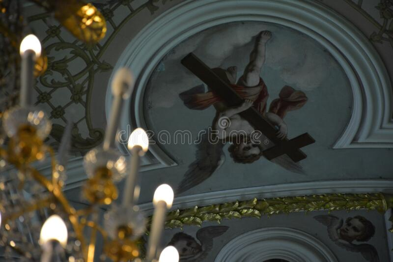 Drawing of an angel in a temple. Drawing of an angel in a Russian Church. Christianity. Faith. Church candles and prayer royalty free stock image