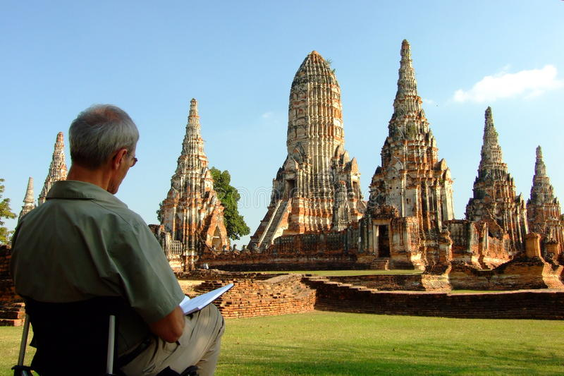 A foreign man are drawing Chaiwatthanaram temple at Ayutthaya Thailand in Ayutthaya royalty free stock photos