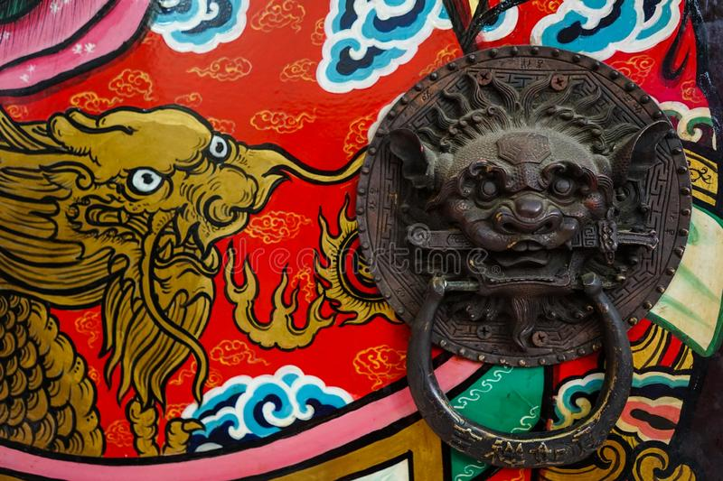 Lion`s door Chinese temple and drawing. At `Pung Tao Kong ` Chinese temple in chiang mai thailand royalty free stock photo