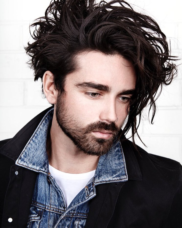 Long curly messy hairstyle for men